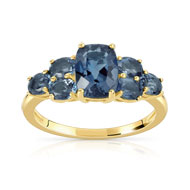 Bague or 375 jaune topaze bleue traitee