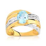 Bague or 750 2 tons topaze bleue traitée et diamant