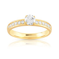 Bague solitaire or 750 jaune diamant 60/100e de carat