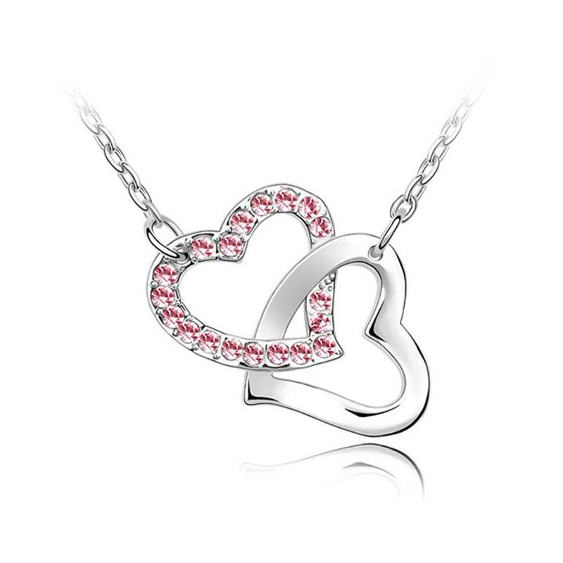 Collier double Coeurs entrelacés orné de Cristal rose de Swarovski et  plaqué rhodium