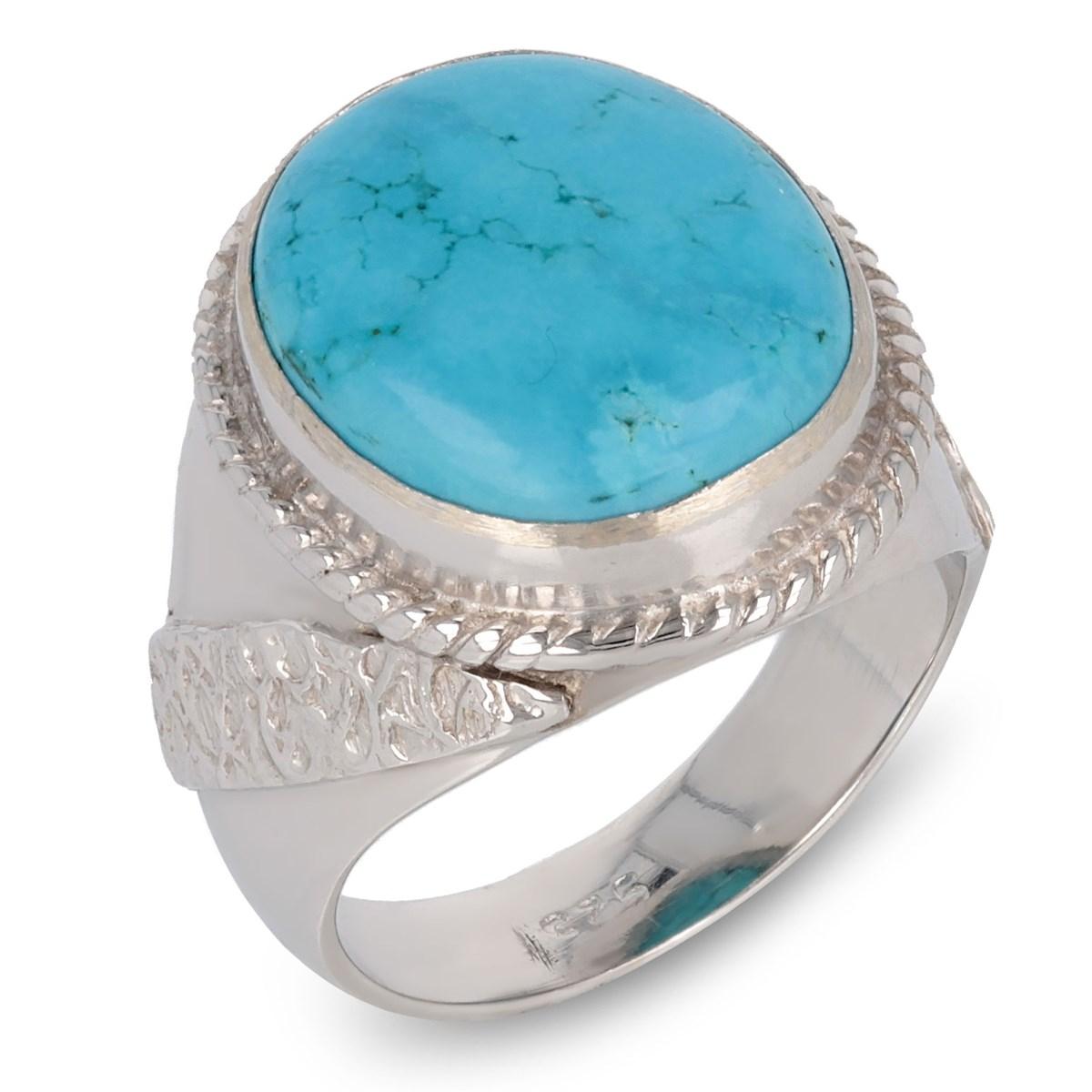 Bague style ethnique en pierre de turquoise sur anneau d argent dessiné sur  les côtés 0771ae79838b